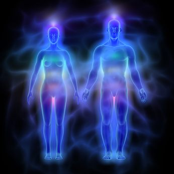 Illustration of human energy body (aura) with chakras - woman and man